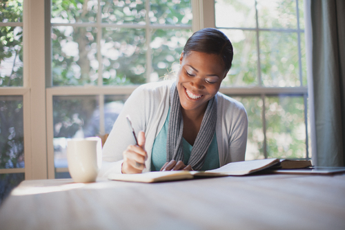 Smiling Woman Studying Bible