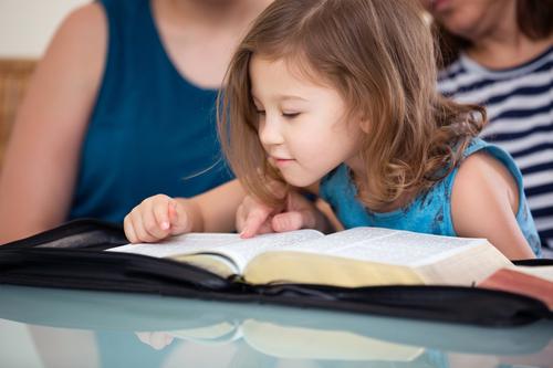sweet girl reading Bible
